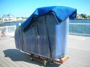 vi flyttat ditt piano och transporterar det dit du vill